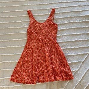 orange and white fit and flare dress